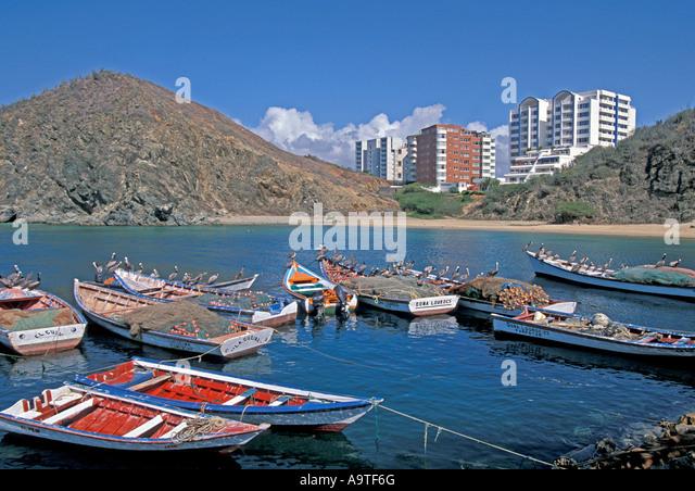 Isla Margarita island Venezuela Porlamar City fishing boats pelicans skyline - Stock Image