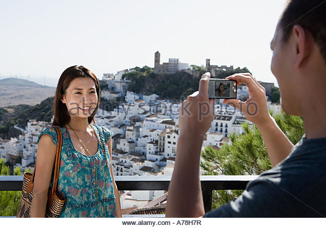 Couple taking pictures - Stock Image
