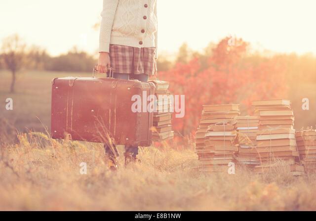 Hipster girl holding a suitcase - Stock-Bilder