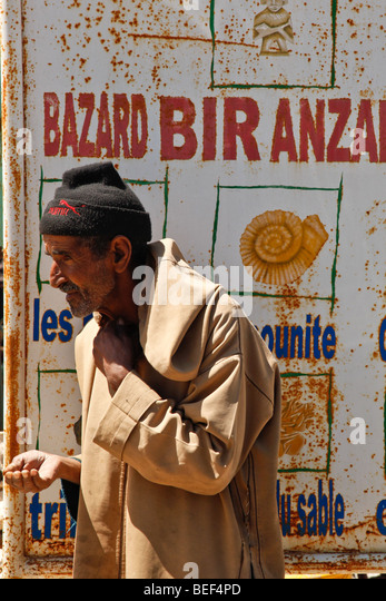 Begging man stood by the road between Marrakesh and Essaouira in Morocco - Stock Image