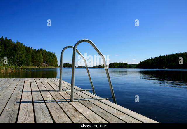 Private jetty in a bay under blue sky, Saimaa Lake District, Finland, Europe - Stock-Bilder