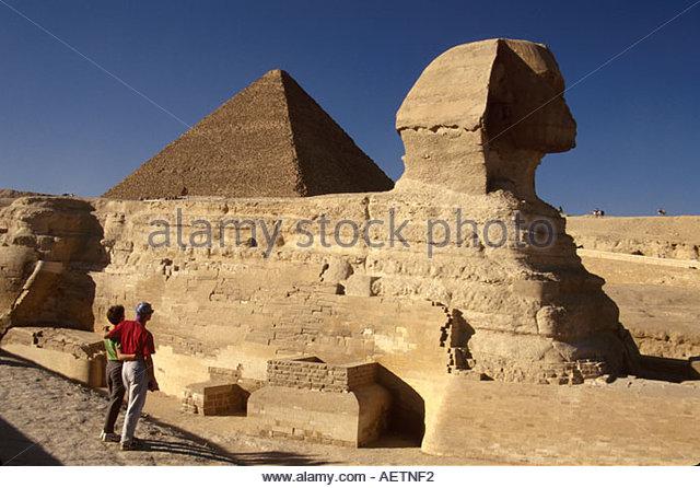 Egypt Cairo Giza District Sphinx face of Pharaoh Khephren lion body rock carving 190 feet long 66 feet high couple - Stock Image