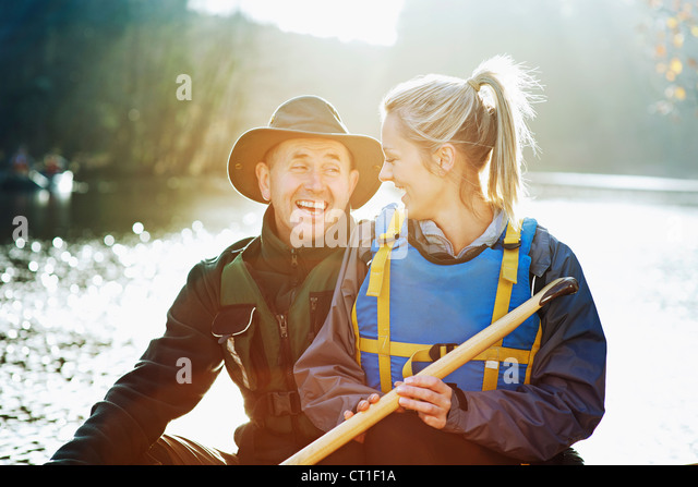 Couple sitting in canoe together - Stock Image