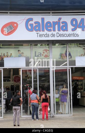 Santo Domingo Dominican Republic Avenida Duarte business discount store storefront window apparel fashion shopping - Stock Image