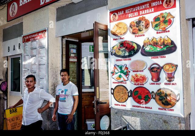 Madrid Spain Europe Spanish Centro Lavapias Calle Argumosa Bar Restaurante India Delhi Darbar restaurant Asian man - Stock Image