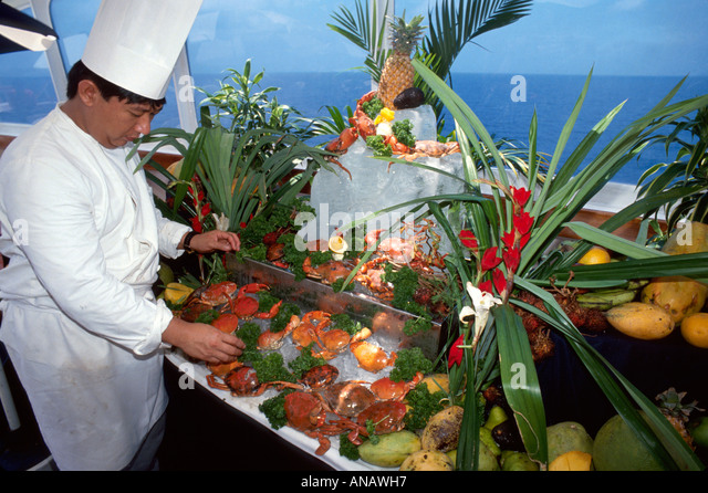 Indonesia South China Sea Ocean Pearl cruise ship seafood banquet Asian chef crab presentation - Stock Image