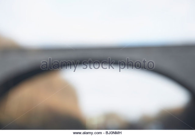 blurred image of motorway bridge - Stock Image