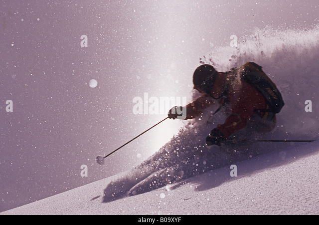 skier on the run in backlight, France, Alps - Stock Image