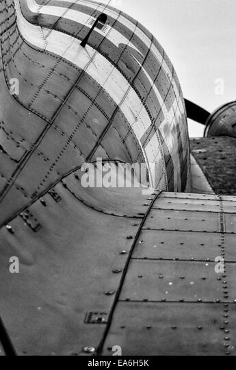 Rear view along the fuselage of a C-47 Dakota WW2 Troop Carrier aeroplane in Black and White - Stock Image