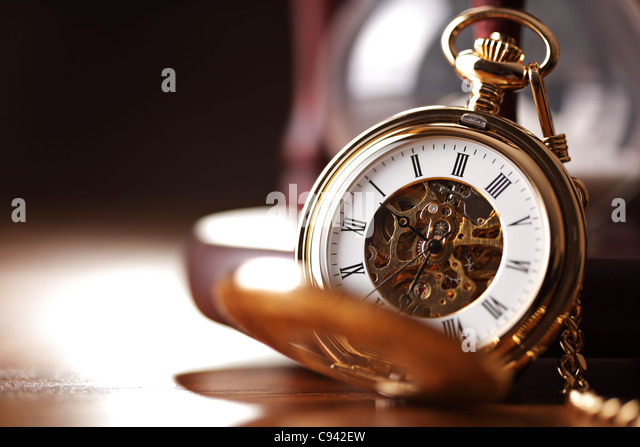Gold pocket watch and hourglass - Stock Image