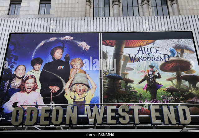 Odeon West End cinema sign with Alice in Wonderland Billboard, Leicester Square, London, England, UK - Stock Image