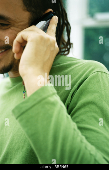 Man phoning, close-up, cropped - Stock Image
