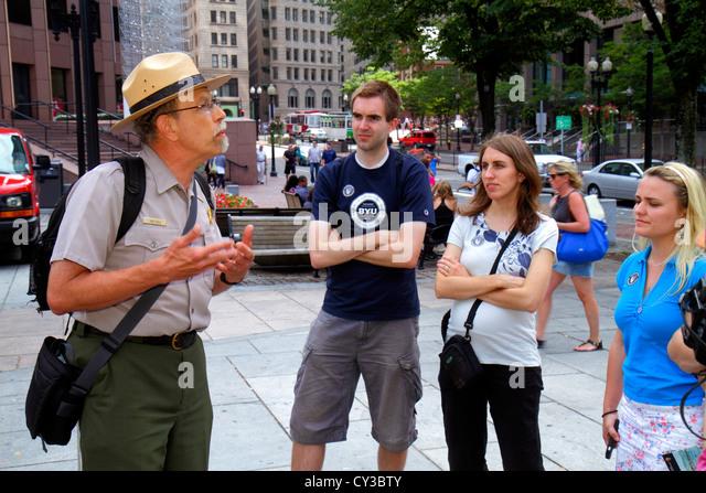 Boston Massachusetts The Freedom Trail Faneiul Hall Marketplace Quincy Market National Park ranger explaining man - Stock Image