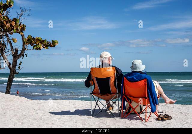 Stuart Florida Hutchinson Island Bathtub Reef Beach senior man woman couple sitting chairs sand dune Atlantic Ocean - Stock Image