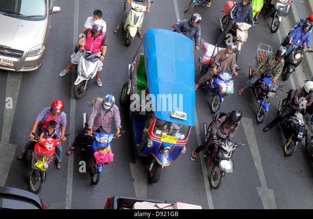 Bangkok Thailand Pathum Wan Phaya Thai Road traffic taxi taxis cabs motorcycles motor scooters auto rickshaw tuk - Stock Image