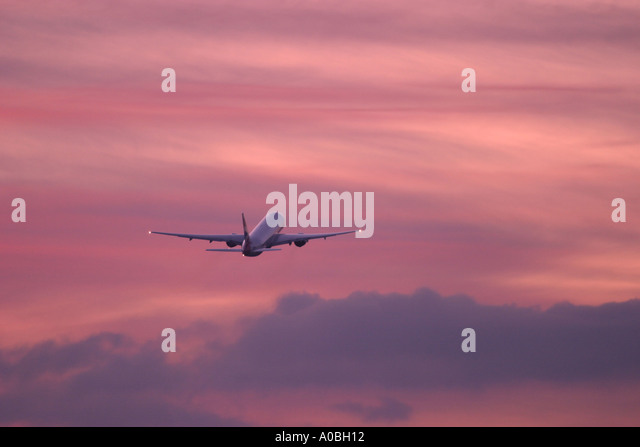 Commercial airplane climbing out after take off - Stock Image