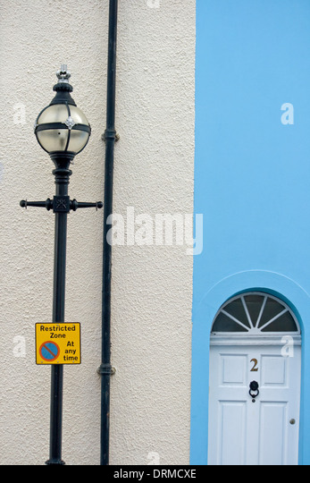 Unusual street lamp and contrasting house colors. - Stock Image