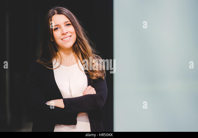young authentic business woman in the city for a buisness trip - Stock Image