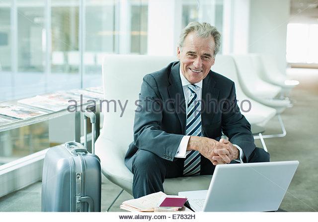 Businessman using laptop while traveling - Stock-Bilder