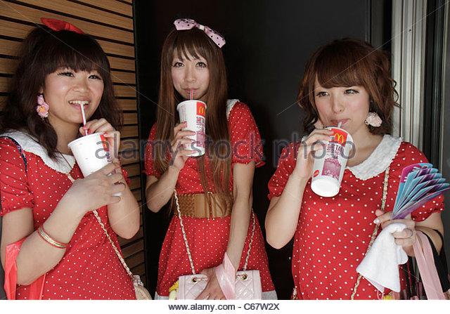 Tokyo Japan Harajuku Takeshita Dori Street shopping shoppers Asian teen girls polka-dot dresses fashion fashionable - Stock Image