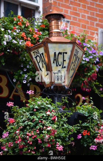 Flower Baskets Dublin : Hanging baskets outside pub stock photos