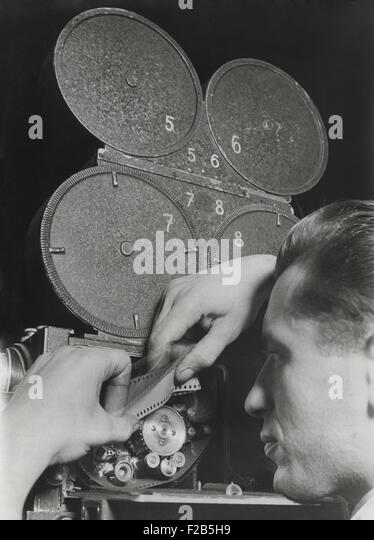 Film engineer using the Dunning Method. Two films running simultaneously in the camera, with the background film - Stock Image