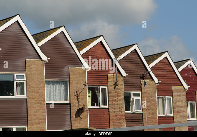 Row of  identical houses built in the 1970's in Tywyn Gwynedd north wales UK - Stock-Bilder