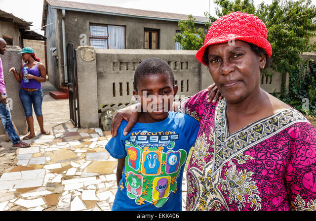 Johannesburg South Africa African Soweto Black woman grandmother boy grandson house home - Stock Image