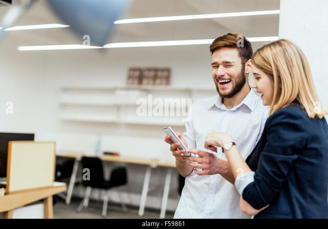 Business people having fun during break and interacting - Stock Image