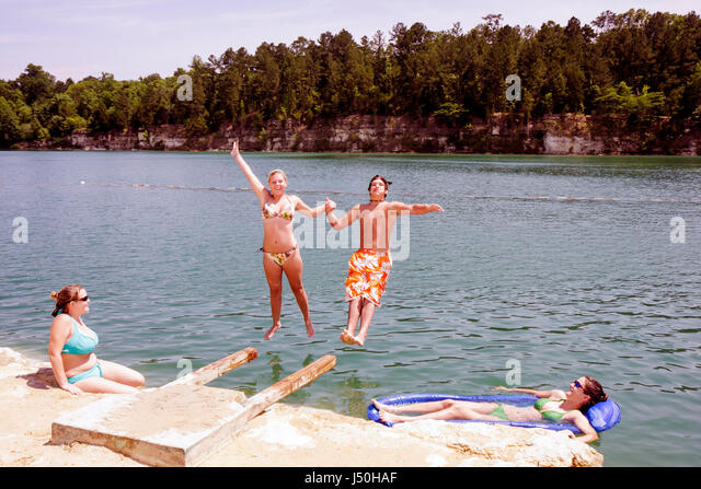 Alabama St. Stephens St. Stephens Historic Site former quarry girl boy teen dive jump swim refresh fun recreation - Stock Image