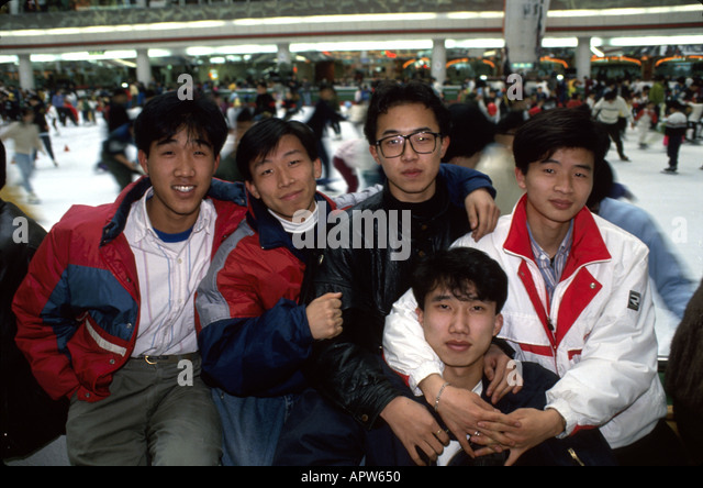 South Korea Asia Far East Seoul Lotte World indoor shopping entertainment complex ice skating rink Asian men teens - Stock Image