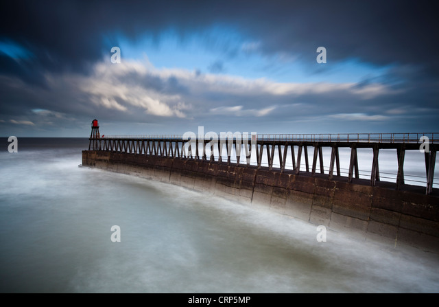 Whitby East Pier Light on the end of the East Pier extension. - Stock Image