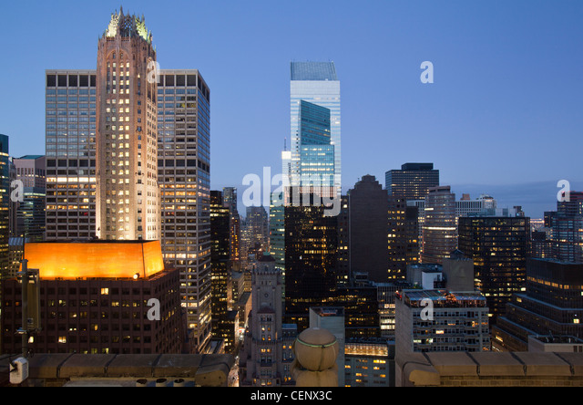 Buildings lit up at dusk downtown Manhattan looking north, New York City, New York State, USA - Stock Image