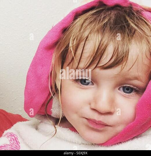 Toddler getting dry after her bath - Stock Image
