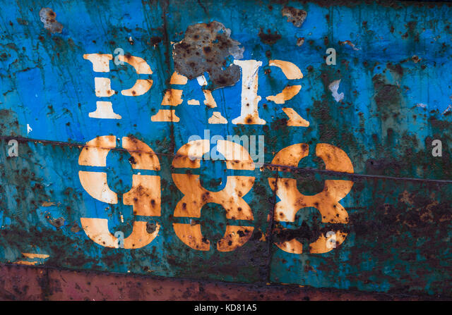 Rusty metal fishing boat hull - Stock Image