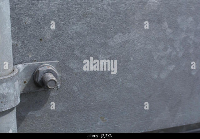 Galvanized steel structure with nut and bolt - possible abstract metaphor for manufacturing and industrial subjects. - Stock Image