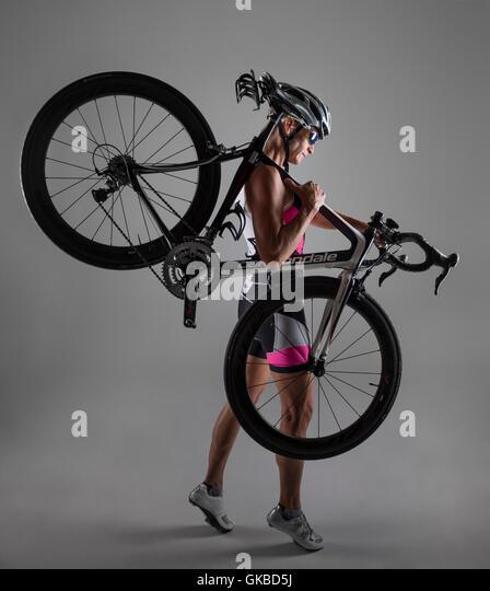 Woman in studio with her mountain bike - Stock Image