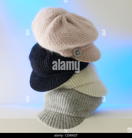 A still life shot of four stacked wool ladies hats - Stock Image