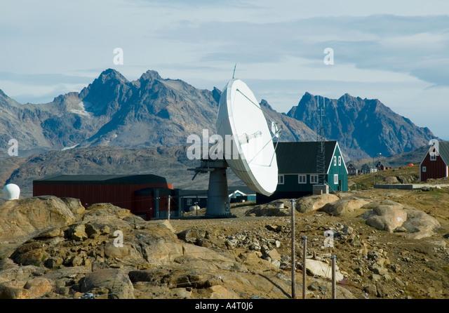 Communications dish at Tasiilaq, Angmagssalik Island, Sermilik Fjord, East Greenland - Stock Image