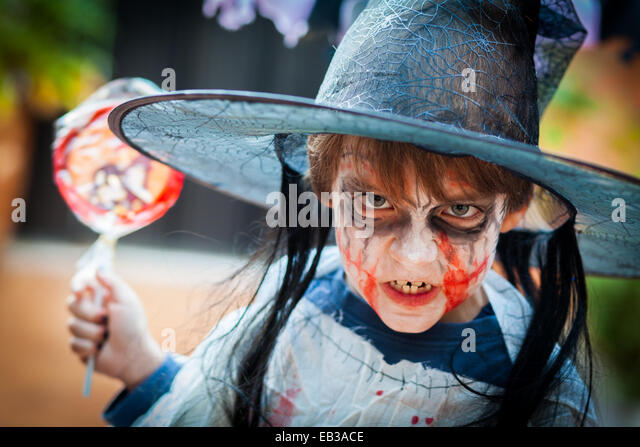 Boy (8-9) with scary costume for Halloween - Stock Image