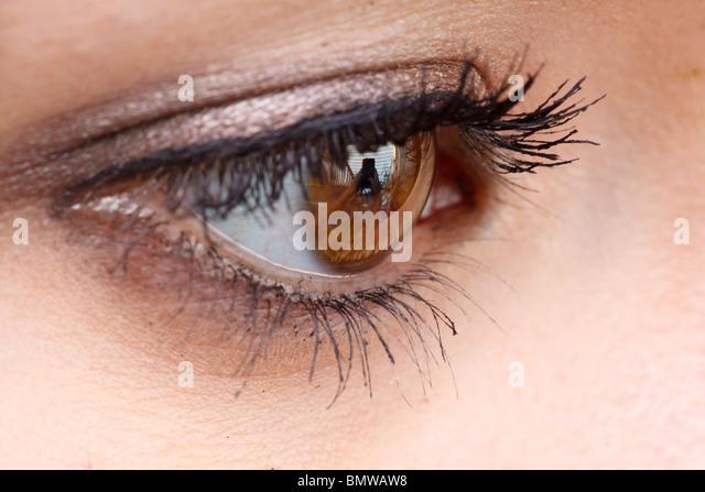 Closeup of teenage girl's eye with mascara. - Stock Image