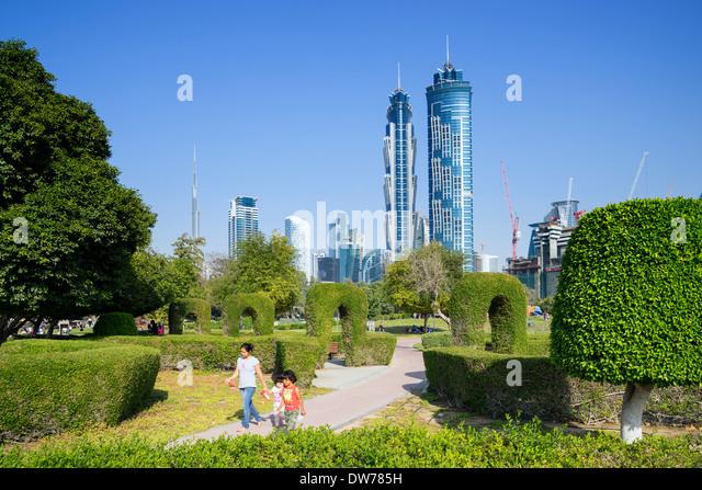 Maze garden and skyline of city from Al Safa Park in Dubai United Arab Emirates - Stock Image