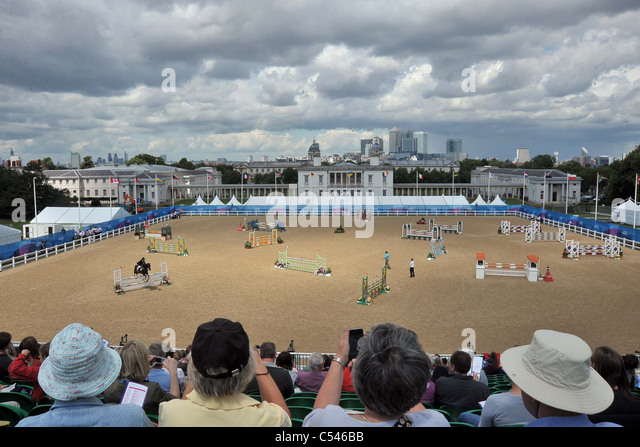 The crowd watch as Andreas Riedl riding Jabadaba Doo (Austria) jumps. Show Jumping Demonstration Competition. Greenwich - Stock Image