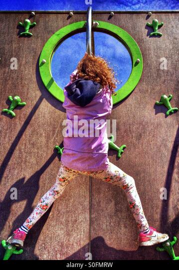 Young girl on climbing wall - Stock Image