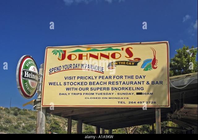 Anguilla Johnno's sign landmark bar restaurant at Sandy Ground beach - Stock Image