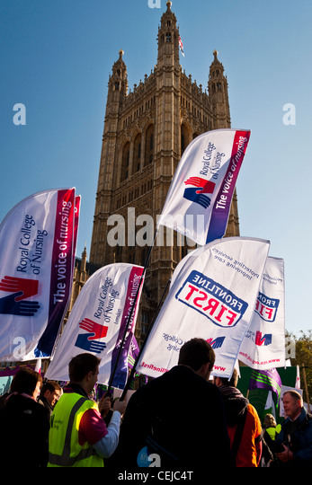 Student nurses outside the Houses of Parliament, London, on the NUS protest against tuition fee rises on November - Stock Image