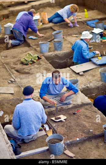Archeologists at an Archeology dig site. - Stock Image