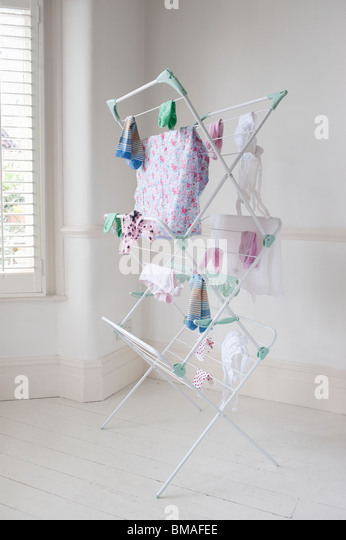 Clothes on laundry airer, London - Stock Image