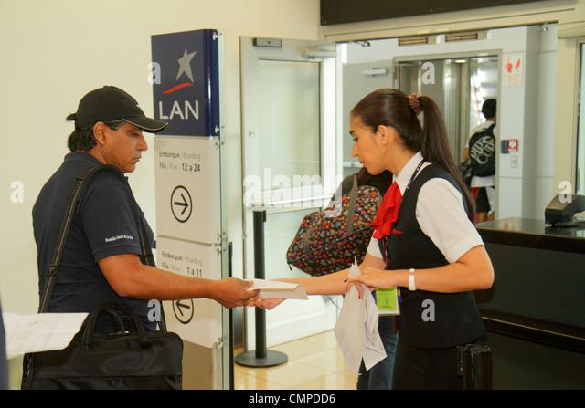 Peru Lima Jorge Chávez International Airport LIM aviation boarding gate LAN airline carrier Hispanic woman - Stock Image