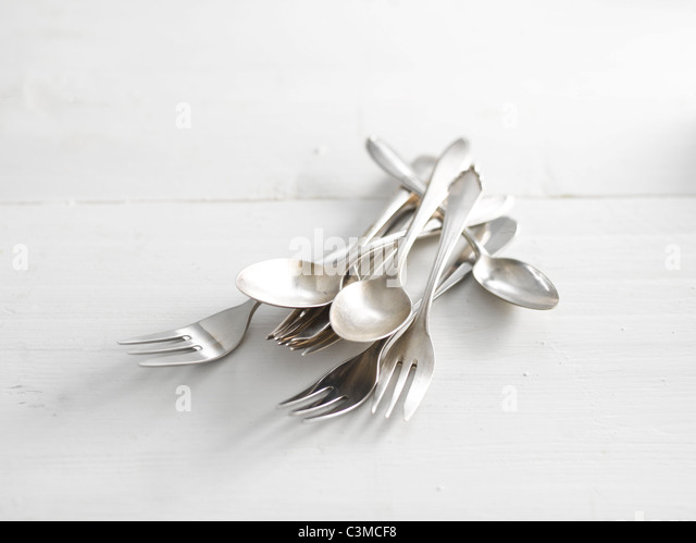 Spoons and forks, close-up - Stock Image